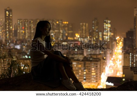 Woman enjoy the city view in Hong Kong from the mountain  - stock photo
