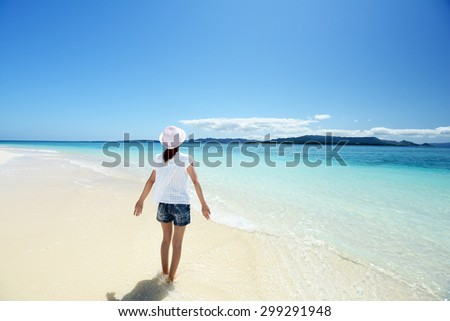 Woman enjoy the sun. - stock photo