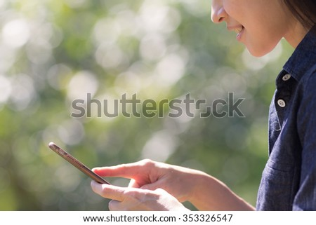 Woman enjoy using on her mobile phone