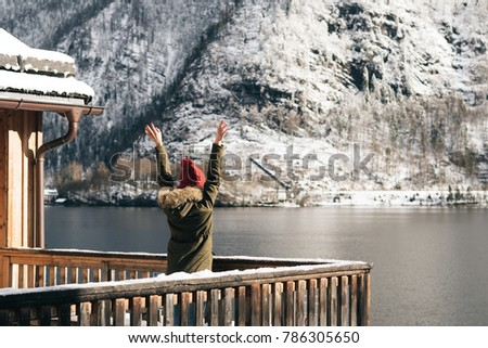 Woman enjoy view from balcony. Carefree winter vacation.