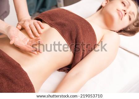 Woman enjoying a Ayurveda oil massage treatment in spa - stock photo