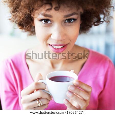 Woman enjoying a cup of tea - stock photo