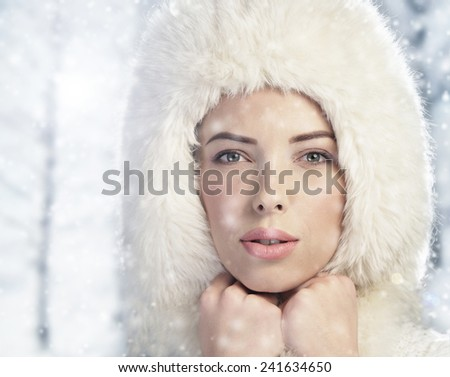 Woman enjoying a snowy day in the woods - stock photo