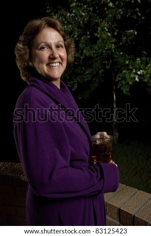 Woman enjoying bedtime herbal tea - stock photo