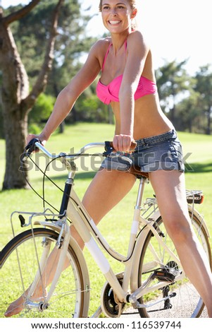 Woman Enjoying Cycle Ride - stock photo