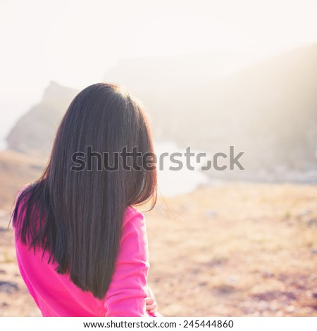Woman enjoying freedom and life on beautiful and magical sunset. relaxed and happy. Photo with instagram style filters  - stock photo