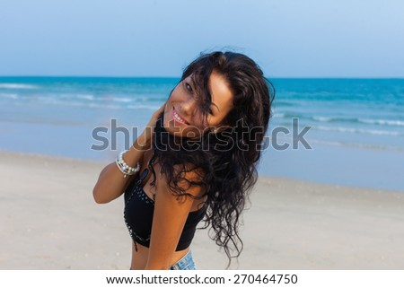 Woman enjoying her day on the beach - stock photo