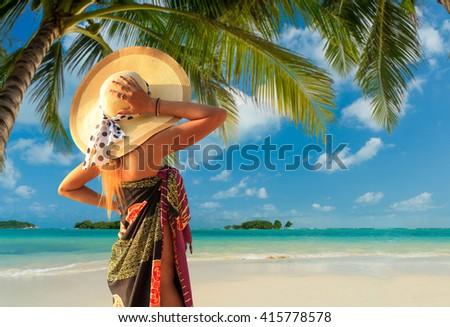 Woman enjoying her holidays on the tropical beach - stock photo