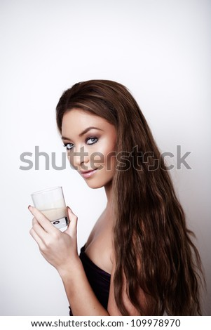 woman enjoying herself drinking from a glass - stock photo