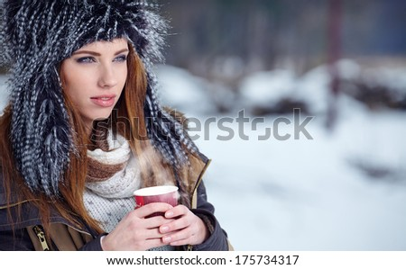 Woman Enjoying Hot Drink In Cafe