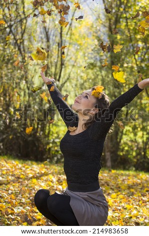 Woman enjoying nature and autumn in the park. - stock photo