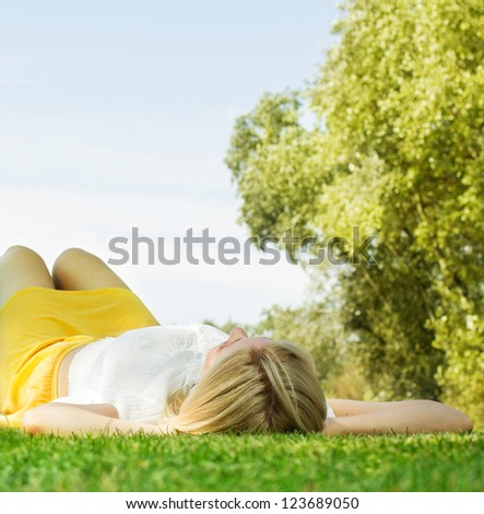 Woman enjoying nature at beautiful summer day. - stock photo