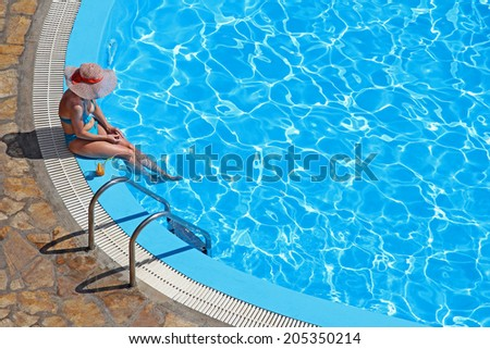 Woman enjoying on vacation in a swimming pool
