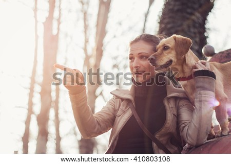 Woman enjoying outdoor with her dog - stock photo