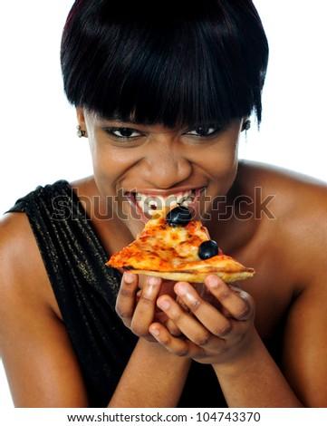 Woman enjoying pie of a pizza isolated on white. Closeup - stock photo