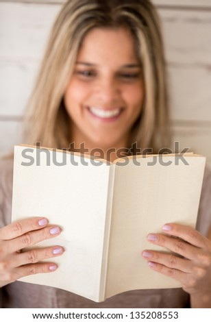 Woman enjoying reading a book at home