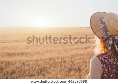 woman enjoying summer sunset, beautiful background with place for text