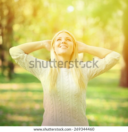 Woman enjoying sun outdoors - stock photo