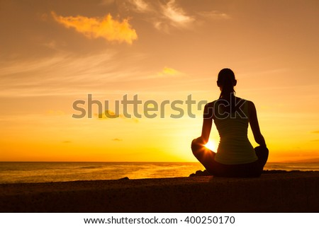 Woman enjoying the beautiful sunset.  - stock photo