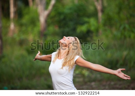 woman enjoying the summer in the forest - stock photo