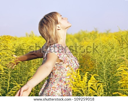 woman Enjoying the sun and summer - stock photo