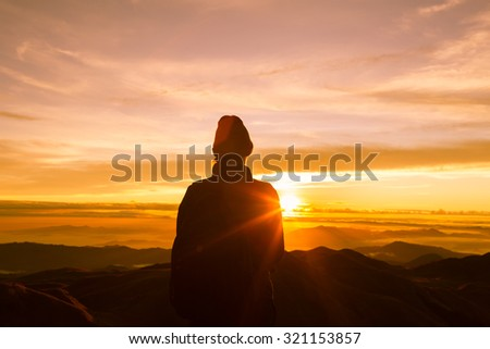 Woman enjoying the sunrise.