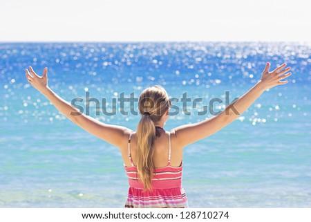 Woman Enjoying the Sunshine at the beach - stock photo
