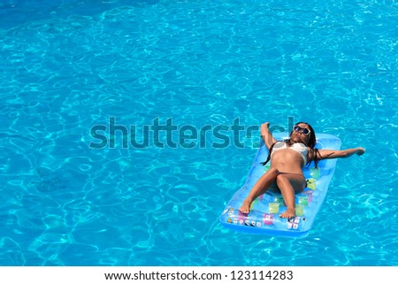 Woman enjoying the swimming pool