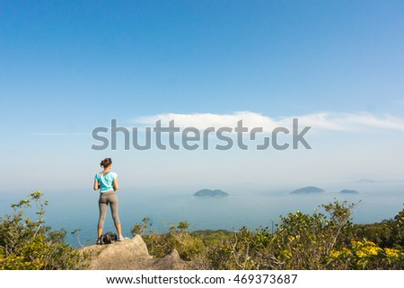 Woman enjoying the view to Three Sisters islands 'ilhas tres irmas', Lagoinha do Leste trail - Florianopolis - Santa Catarina - Brazil