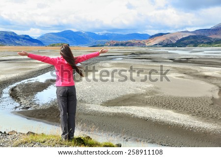 Woman enjoying view of Iceland black sand dunes in south Icelandic nature landscape. Serene person relaxing soaking in the natural beauty. Tourist visiting landmarks tourists attractions. - stock photo