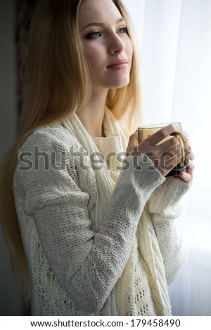 woman enjoys fresh coffee in the morning with sunrise at home lifestyle - stock photo