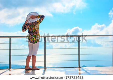 woman enjoys the view from the heights