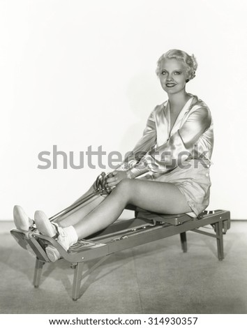 Woman excersing on rowing machine