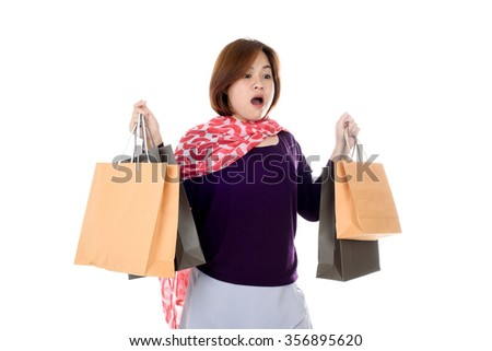 Woman exciting holding few shopping bags isolated on white background. - stock photo