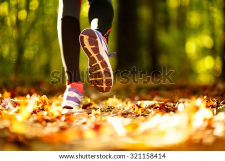 Woman exercise walking outdoors, shoes closeup - stock photo