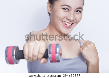 Woman exercise with dumbbell