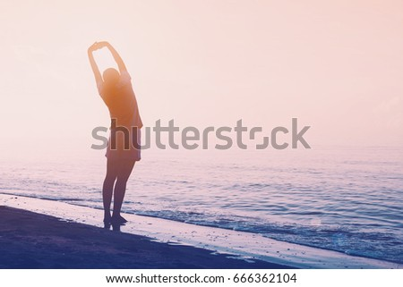 Woman exercise with yoga on the beach background with vintage filter
