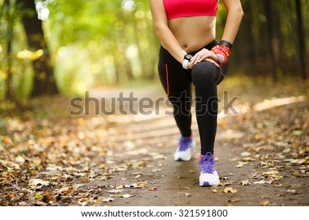 woman exercising and stretching muscles before sport activity in park - stock photo