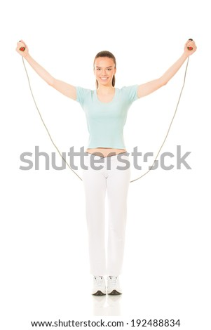 Woman exercising fitness jumping rope in  - stock photo