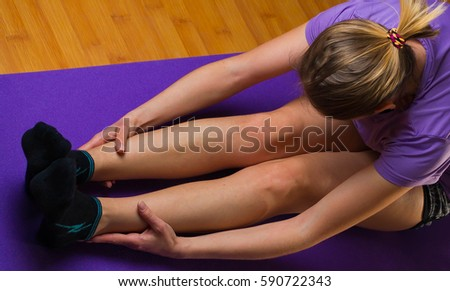 Woman exercising her abs on a Pilates ball. Natural light., pilates, woman,