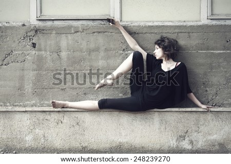 Woman exercising in ruin building