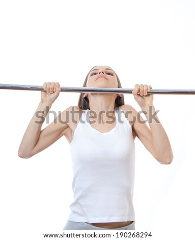 woman exercising on pull-up bar , isolated on white background