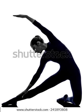 woman exercising parighasana gate pose yoga silhouette shadow white background - stock photo