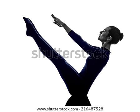 woman exercising paripurna navasana boat pose yoga silhouette shadow white background - stock photo