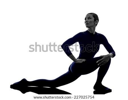 woman exercising Parivrrta Parsvakonasana Revolved Extended Side Angle pose yoga silhouette shadow white background - stock photo