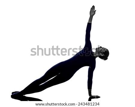 woman exercising Vasisthasana side plank pose yoga silhouette shadow white background - stock photo