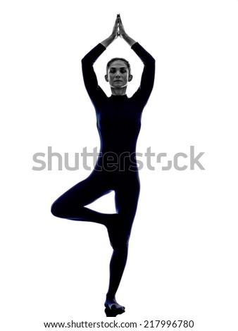 woman exercising Vrksasana tree pose yoga silhouette shadow white background - stock photo