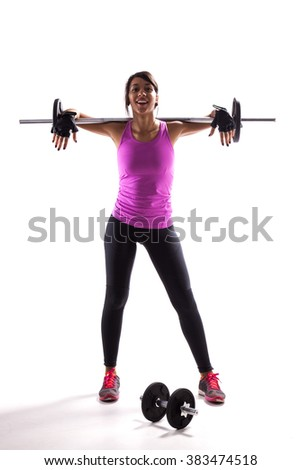 Woman exercising with a barbell weight - stock photo