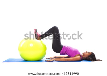 Woman exercising with a fitness ball - stock photo