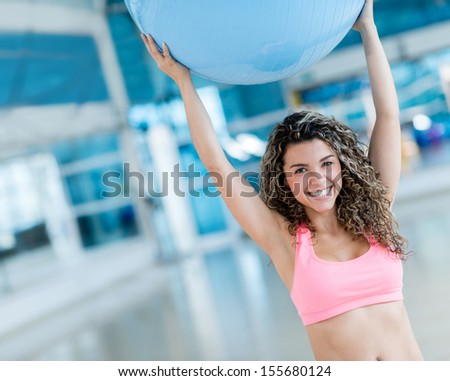 Woman exercising with a Pilates ball at the gym  - stock photo